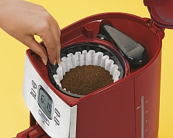 Loading the drip coffee machine with grounds