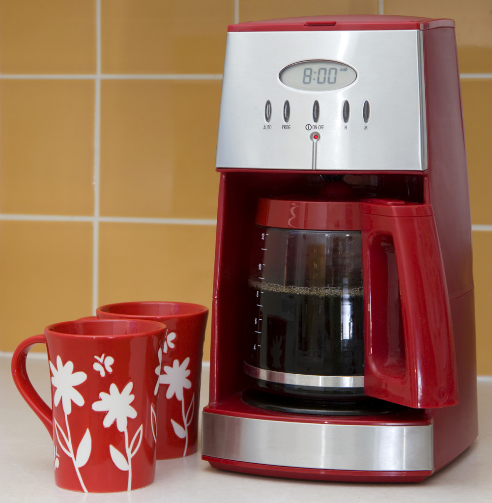 Red Drip Coffee Machine and Coffee Mugs